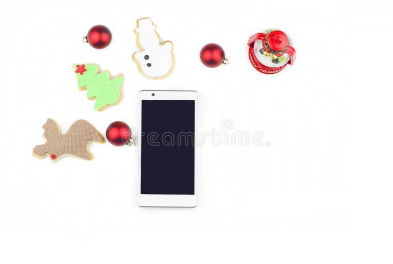 Teléfono elegante con la decoración de la Navidad fotos de archivo libres de regalías