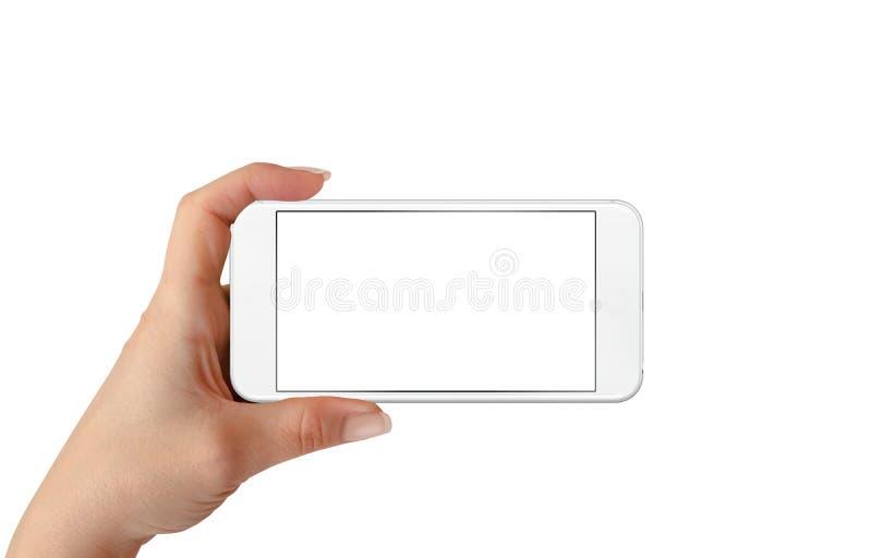 Teléfono elegante en mano de la mujer Posición horizontal Pantalla aislada para la maqueta fotos de archivo libres de regalías