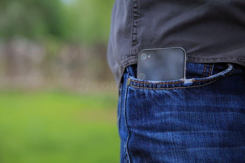 Teléfono en bolsillo fotografía de archivo libre de regalías