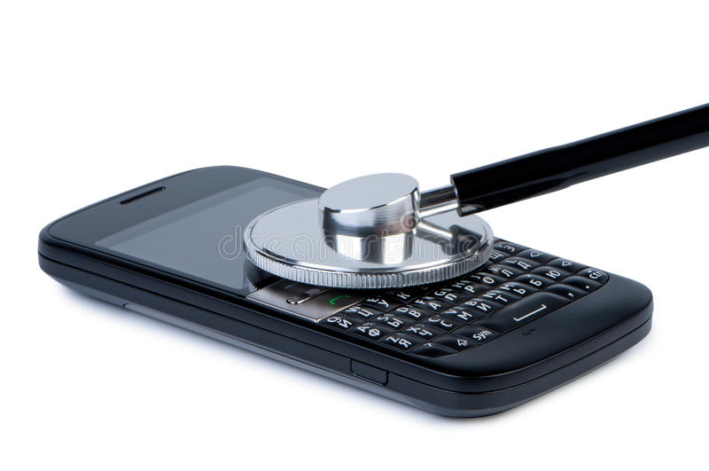 Teléfono móvil con el estetoscopio fotografía de archivo