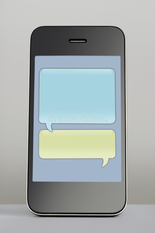 Teléfono móvil con la burbuja del discurso del mensaje de texto imágenes de archivo libres de regalías