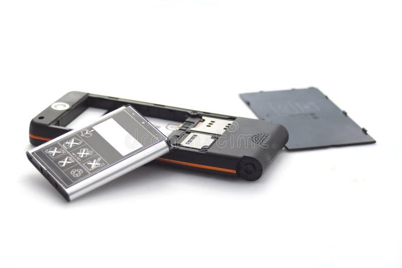 Teléfono móvil de Brocken aislado en blanco fotografía de archivo libre de regalías