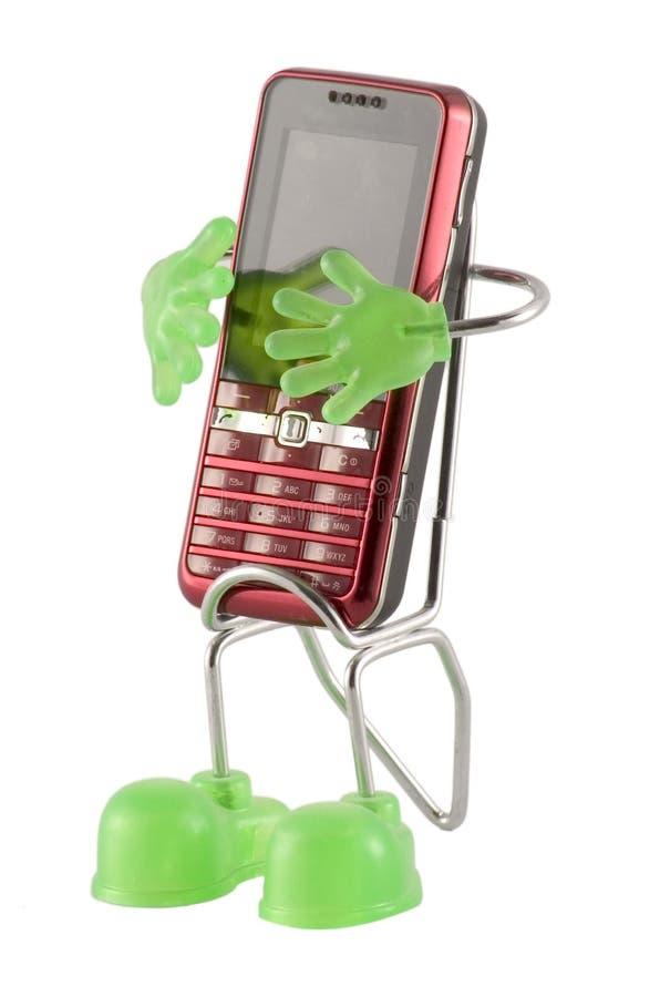 Teléfono móvil en su base imágenes de archivo libres de regalías