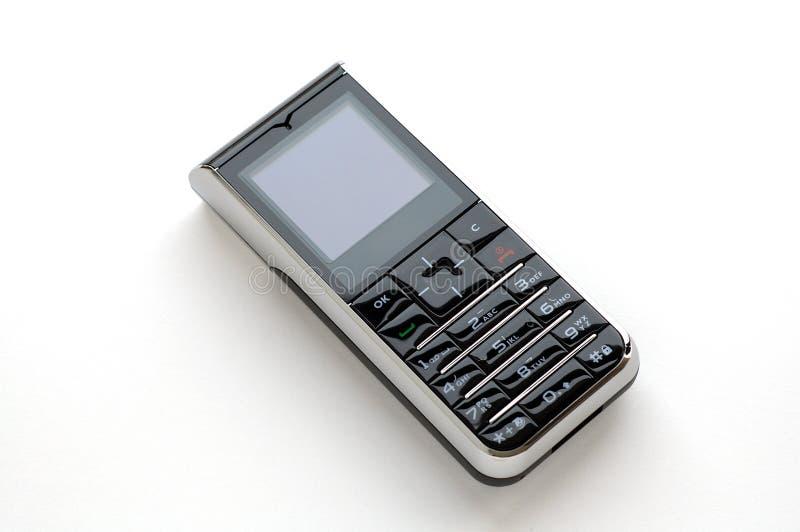 Teléfono móvil moderno con el fondo blanco fotografía de archivo libre de regalías