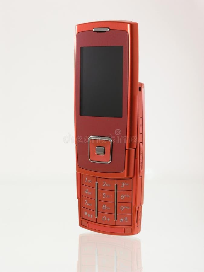 Teléfono móvil rojo fotografía de archivo libre de regalías