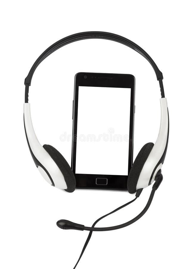 Teléfono móvil y auriculares imagen de archivo