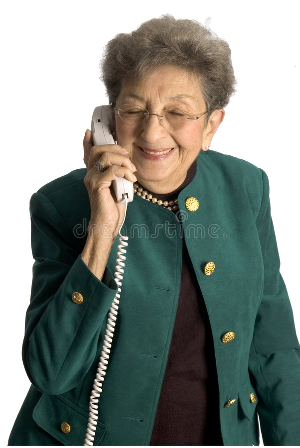 Teléfono mayor de la mujer fotos de archivo