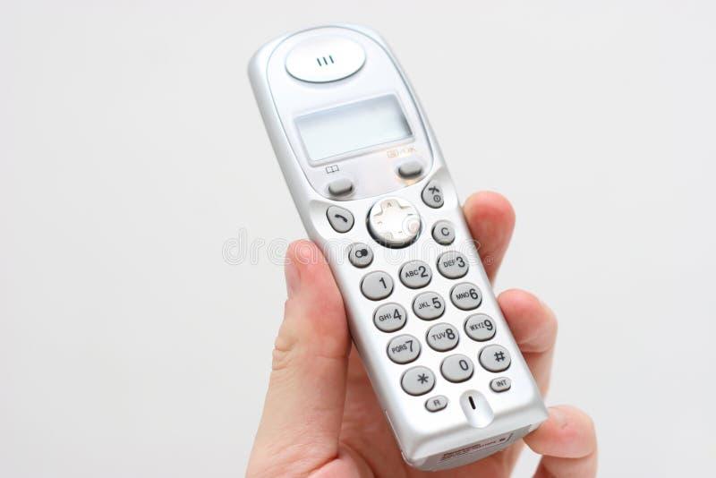 Teléfono moderno a disposición foto de archivo libre de regalías