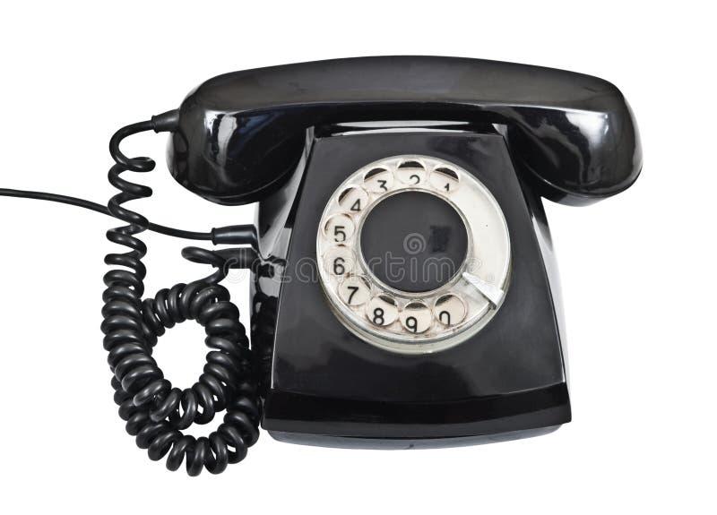 Teléfono negro viejo aislado fotos de archivo