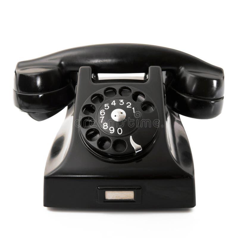 Teléfono obsoleto en el fondo blanco fotos de archivo