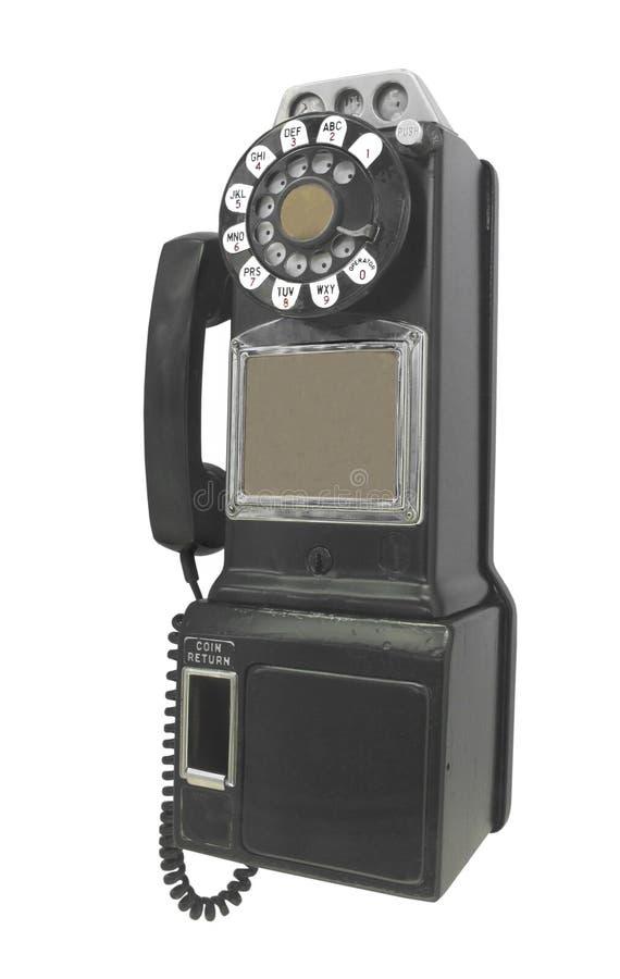 Teléfono público del vintage aislado. foto de archivo