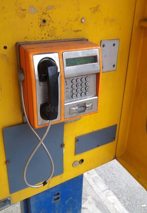 Teléfono público viejo foto de archivo