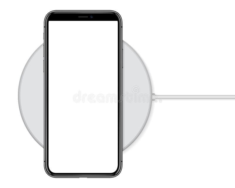 Teléfono que carga en cargador inalámbrico fotos de archivo libres de regalías