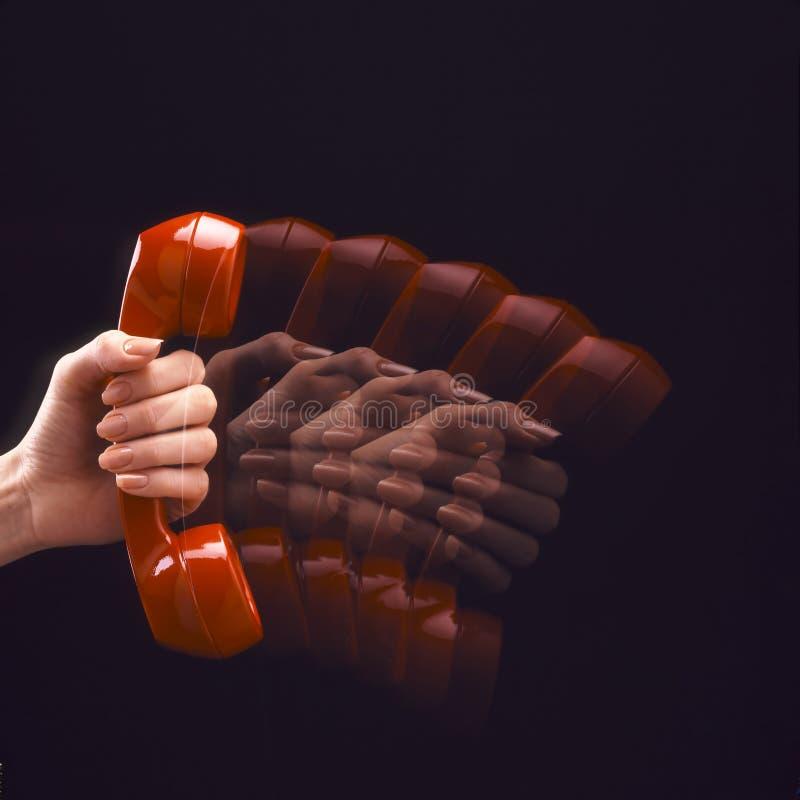 Teléfono rojo en el movimiento fotos de archivo libres de regalías
