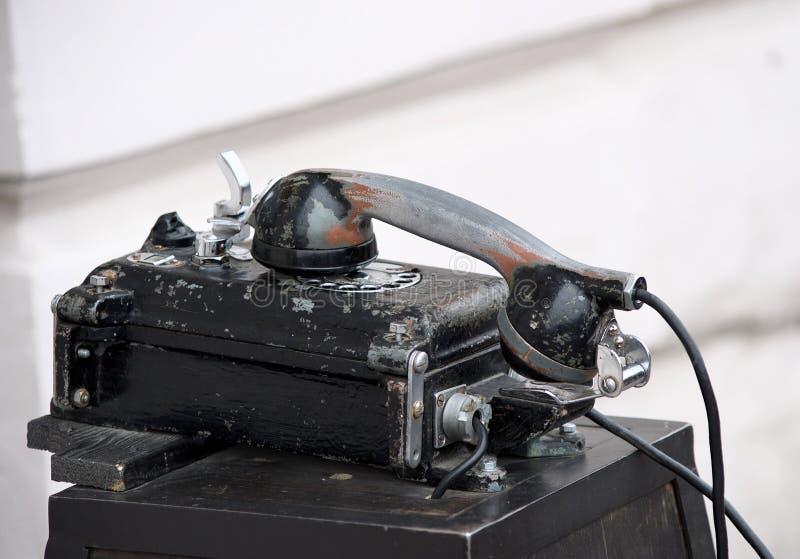 Teléfono viejo vendimia retro negro foto de archivo libre de regalías