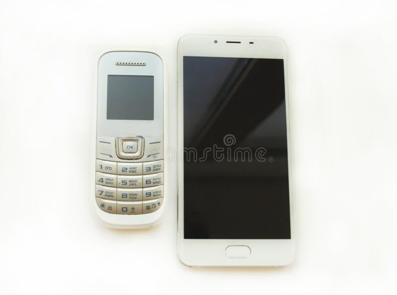 Teléfono viejo y un nuevo smartphone fotografía de archivo