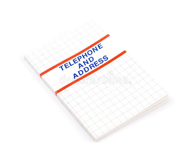 Teléfono y agenda fotos de archivo
