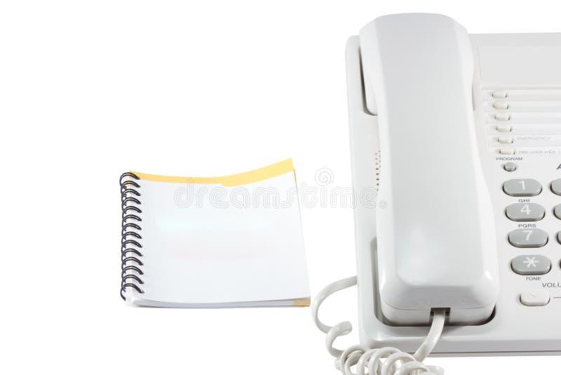 Teléfono y guía telefónica. fotografía de archivo libre de regalías