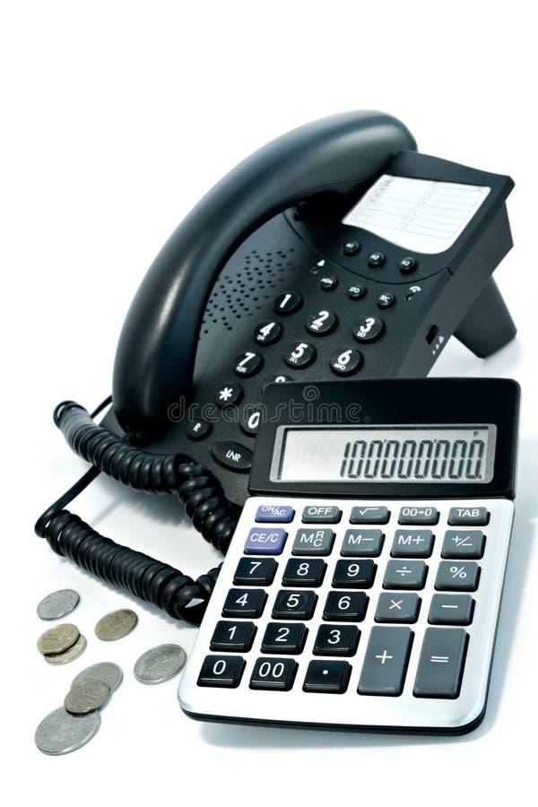 Teléfono y la calculadora imagen de archivo libre de regalías