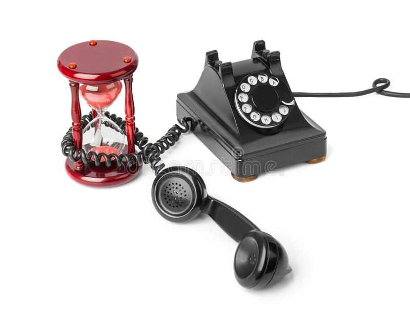 Teléfono y reloj de arena del vintage fotografía de archivo