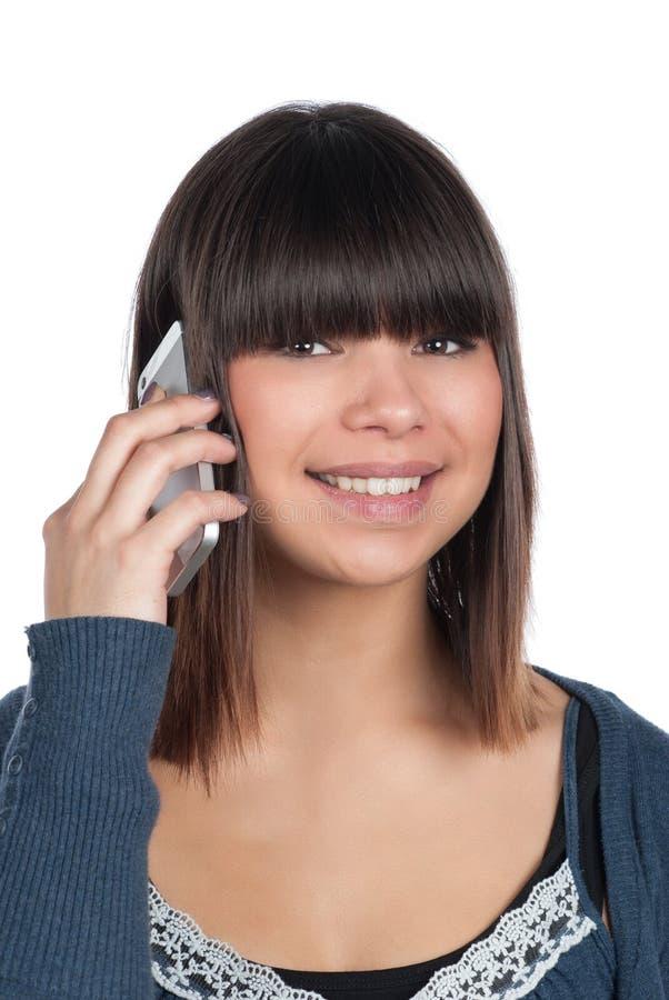 Teléfonos de la mujer joven con un smartphone imagen de archivo
