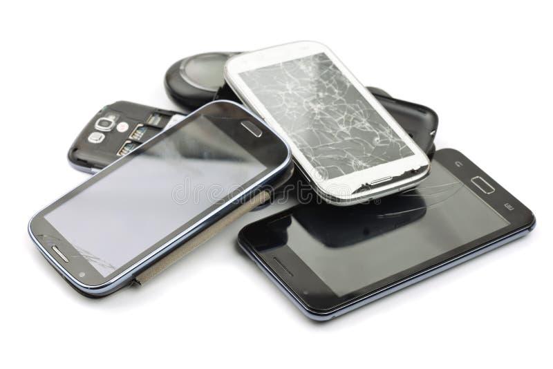 Teléfonos elegantes quebrados fotografía de archivo libre de regalías
