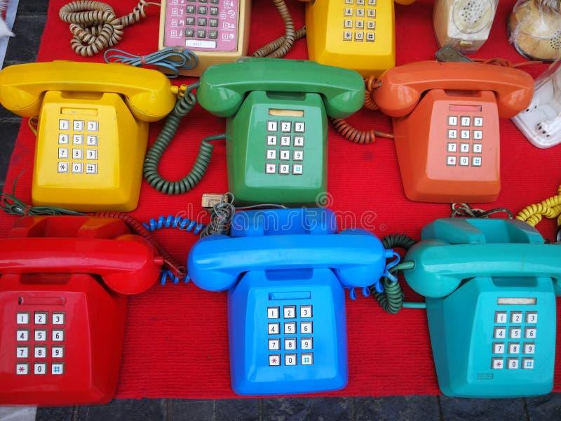 Teléfonos viejos de Colourfull fotos de archivo libres de regalías