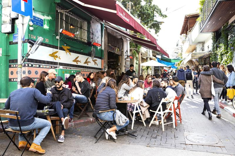 Young people at the restaurant in Carmel market, Israel stock image