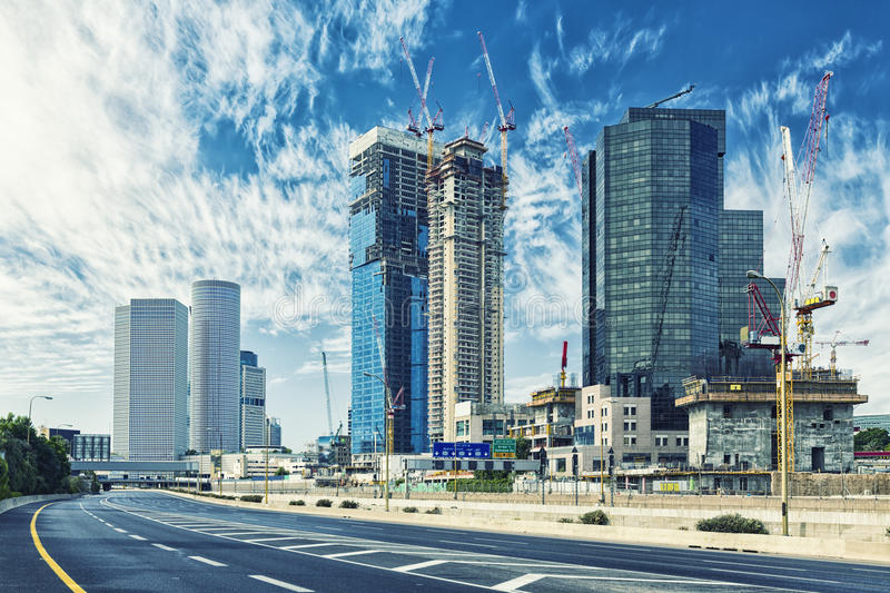 Tel Aviv Cityscape In Daylight, New Skyscraper Under Constraction and Empty Aylon Freeway. royalty free stock photography