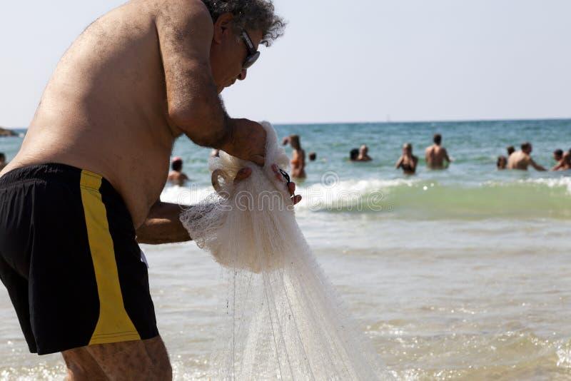 Download Fisherman Pulling Net On Tel-Aviv Beach Editorial Stock Photo - Image: 30141268