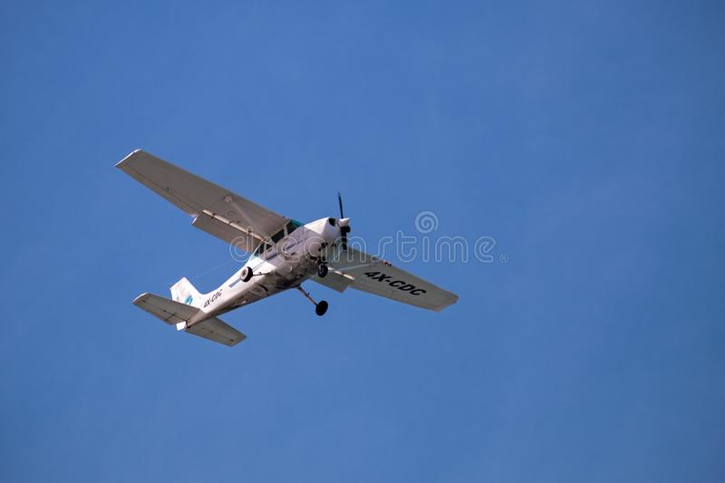 Cessna 172S (4X-CDC) flying on blue sky background. TEL-AVIV, ISRAEL - JANUARY 11, 2019: Cessna 172S (4X-CDC) flying on blue sky background royalty free stock photo