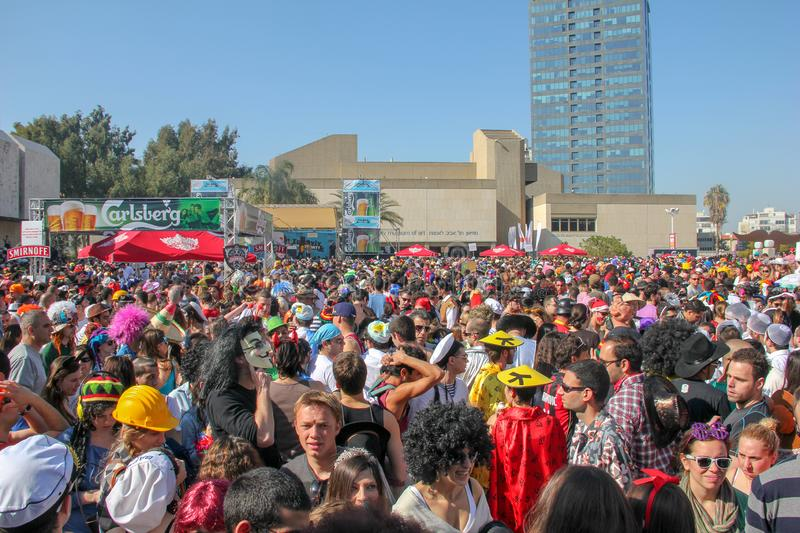 Tel Aviv / Israel - March 9 2012: Big street Purim party, many people wearing masks and costumes. stock image