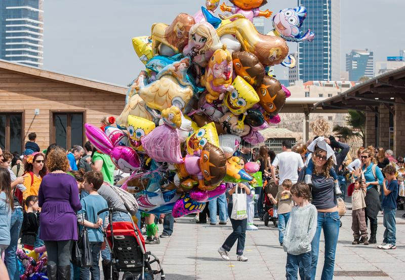 Happy people celebrate the Purim holiday at Tel Aviv`s Old Railw royalty free stock image