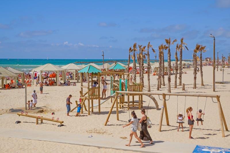 People sunbathes on the beach  in Tel Aviv, Israel royalty free stock images