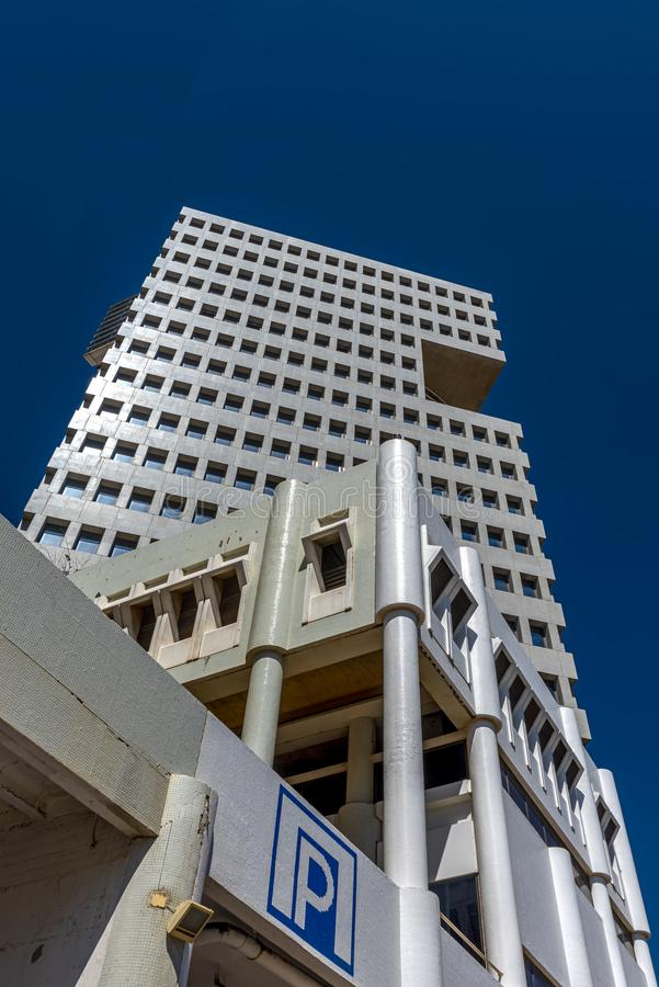 Tel Aviv Israel May 19, 2019 View from a low point of view on a white modern skyscraper that shimmers against. Tel Aviv Israel May 19, 2019 royalty free stock photos
