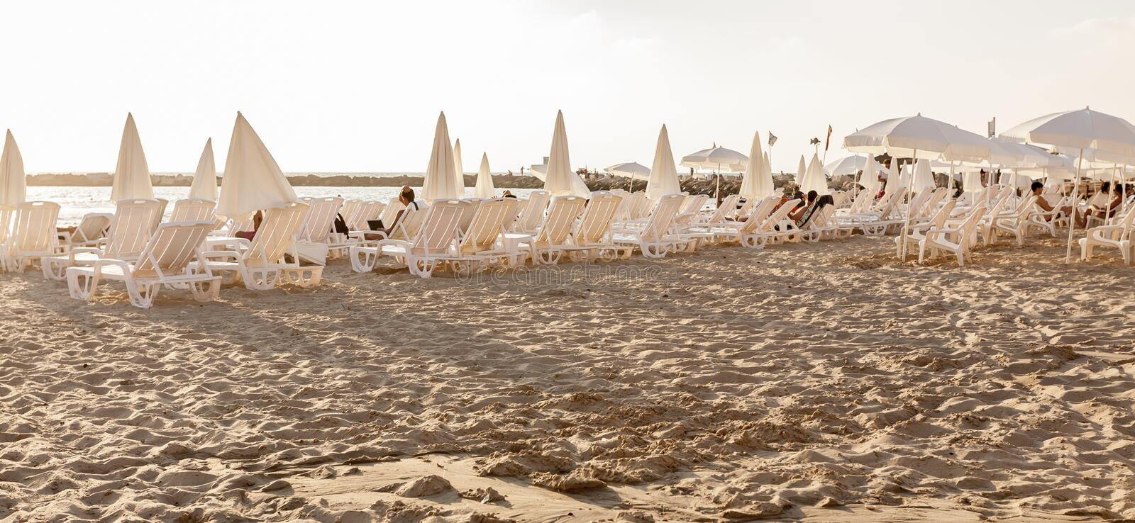 Tel Aviv, Israel - September 8, 2011: People relaxing on the beach in Tel Aviv stock images