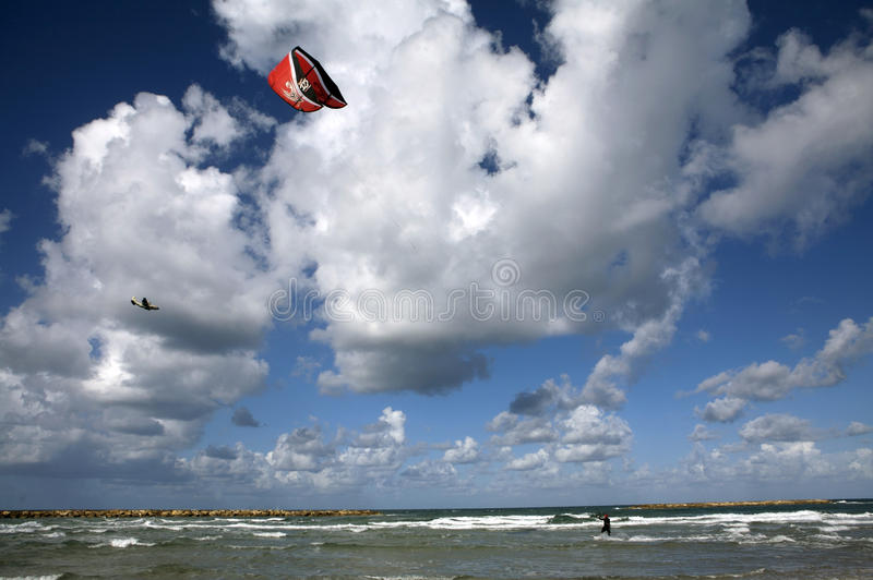 Tel Aviv Kite Surfing. On a beautiful breezy day in Tel Aviv, people were out kite surfing royalty free stock image