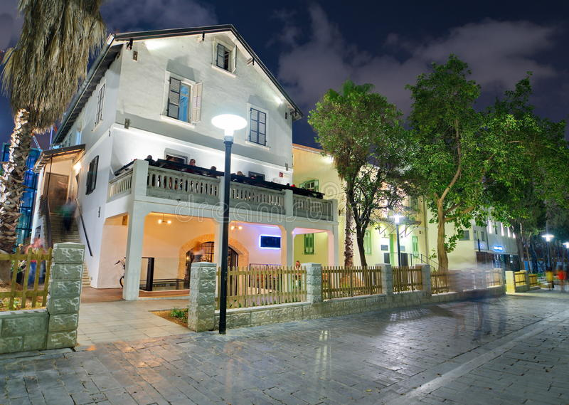 Tel Aviv Night Life. Restored houses at night at the hip Sarona district featuring rich night life and conserved Templer era German architecture from the late stock photography
