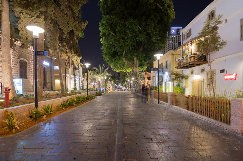 Tel Aviv Night Life. TEL AVIV - SEPT. 25, 2015: Tel Aviv Night Life - Restored houses at night at the hip Sarona district featuring rich night life and conserved royalty free stock images
