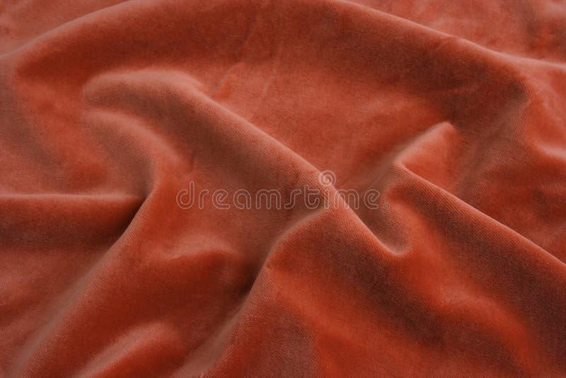 Tela anaranjada del terciopelo foto de archivo