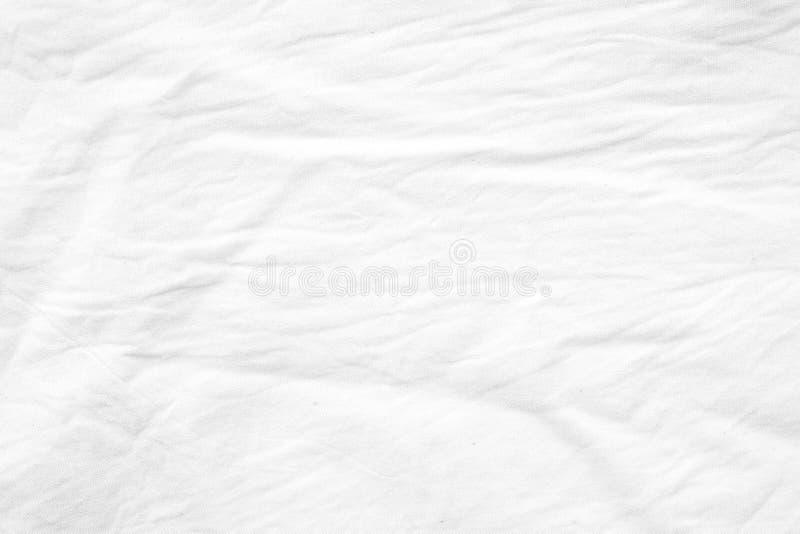 A tela branca enrugada da lona do algodão textured o fundo, wallpap fotos de stock royalty free