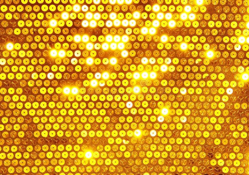Tela con las lentejuelas redondas del oro imagen de archivo libre de regalías