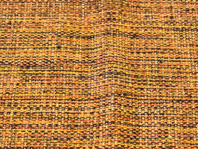 Tela de algodón grosera, mezclada con amarillo, negro y la naranja foto de archivo