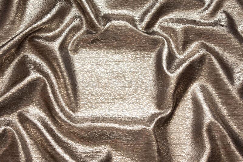 Tela de bronce ondulada de seda brillante hermosa imagenes de archivo