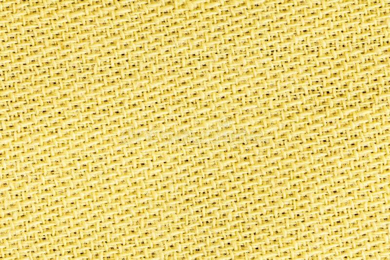 Tela de lino amarilla del fondo de la textura del paño Detalle del primer del material de materia textil fotografía de archivo libre de regalías