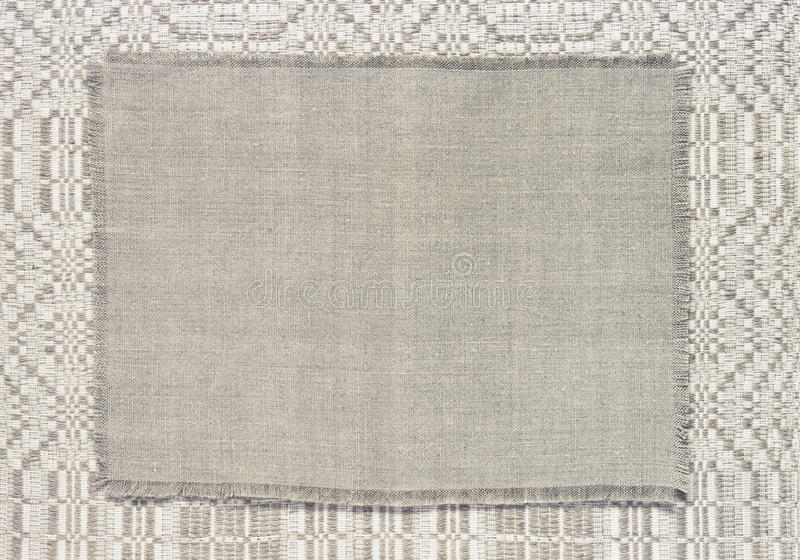 Tela de lino del fondo con un modelo de tejer imagenes de archivo