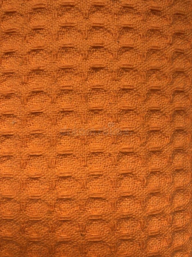 Tela de materia textil anaranjada de algodón para la textura, el fondo o el papel pintado foto de archivo libre de regalías