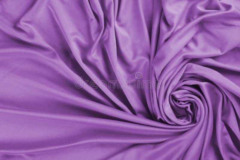 Tela de satén púrpura imagenes de archivo