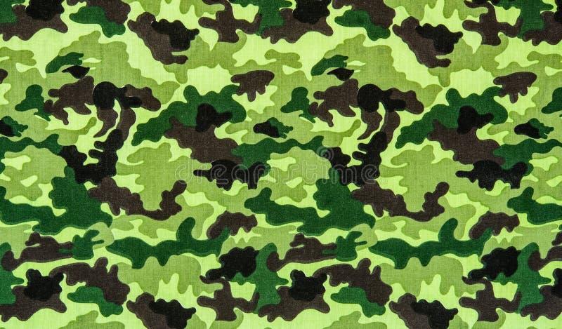 Tela en camuflaje de los militares fotos de archivo
