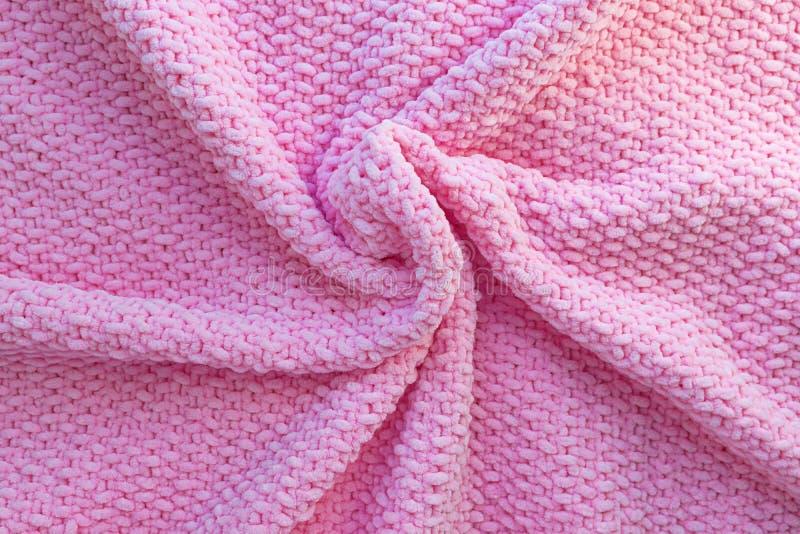 Tela escocesa hecha punto rosada brillante hecha del hilado suave de la felpa Textura de la tela de lana Arte hecho a mano imagen de archivo